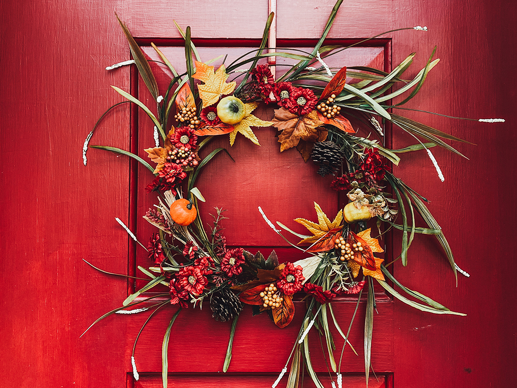 fall wreath on a red door